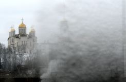A vintage look at icy Russia and the golden domes of an Orthodox Church. Russia, the world's largest nation, borders European and Asian countries as well as Royalty Free Stock Image