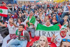 Russia 2018 World Cup Iranian football fans watch match. St. Petersburg, Russia - June 25, 2018: Russia 2018 World Cup Iranian football fans watch match on royalty free stock images