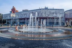 Russia, Yaroslavl August 04 2018 . Children swim in the street in the fountain in hot weather. Extreme heat Royalty Free Stock Images