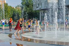 Russia, Yaroslavl August 04 2018 . Children swim in the street in the fountain in hot weather. Extreme heat Royalty Free Stock Image