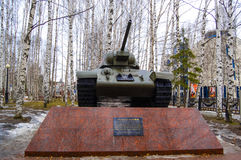 5.04.2012 Russia, YUGRA, Khanty-Mansiysk, Khanty-Mansiysk, the T-34 Tank on the pedestal installed in the `memory Park`. The monum Stock Image