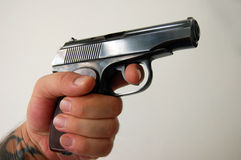 Russian. Hand with gun Royalty Free Stock Image