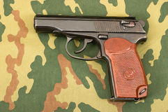 Russian 9mm handgun. On a camouflaged background Royalty Free Stock Photography