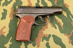 Russian 9mm handgun. On a camouflaged background Stock Images