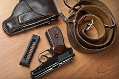 Russian 9mm handgun PM (Makarov). On the table with holster, belt and empty pistol holder Stock Photo