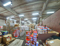 Russian abandoned factory adapted for the grocery storehouse. Royalty Free Stock Photo