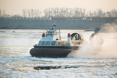 Russian ACV Hovercraft in Action on a Frosen River. Air Cushion Royalty Free Stock Photo