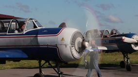 Russian Aerobatics airplane Yak 52 before take off stock video footage