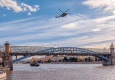 Russian Air Force helicopter flies over Gorky Park and Pushkin Bridge royalty free stock photography