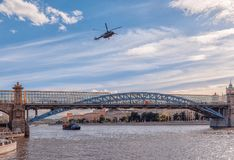 Russian Air Force helicopter flies over Gorky Park and Pushkin Bridge stock photo