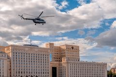 Russian Air Force helicopter flies over the Ministry of Defense of the Russian Federation stock image