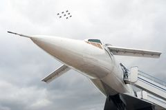 Russian airplane TU-144 and eight planes in sky. Russian supersonic airplane Tupolev Tu-144 Royalty Free Stock Photo