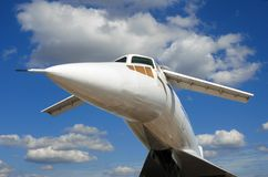 Russian airplane TU-144 under the blue sky. Russian airplane TU-144 general view on blue sky and clouds background Royalty Free Stock Photography