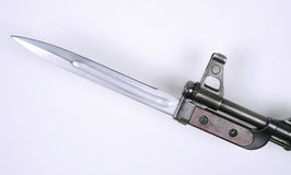 Russian AK47 bayonet. Early pattern Russian bayonet for the AK47 Kalashnikov type assault rifle, fitted to the weapon's barrel royalty free stock photo