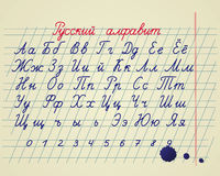 Russian alphabet. Hand drawing russian letters and numbers on school notebook Stock Images