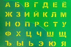 Russian alphabet is drawn on a wooden background using a stenci stock photo