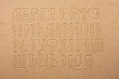 Russian alphabet  written on the sand Stock Images