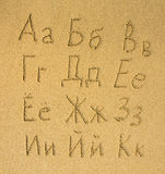 Russian alphabet written on a sand beach. Royalty Free Stock Images