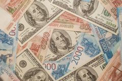 Russian and American banknotes. Five thousand rubles. Two thousand rubles. One hundred dollars. Banking, world economy, Russian money, wooden rubles, American stock photos