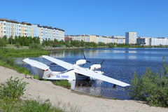 The Russian amphibian on water. NADYM, RUSSIA - JUNE 22, 2016: The Russian  L-42m RA-1948G hydroplane on the bank of a city pond Stock Photo