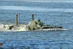 Russian APC BTR-80. Russian APC BTR-80 crossing the river on maneuvers Royalty Free Stock Photo