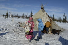 Russian Arctic Aboriginal women with children in the apartment house - the plague! Royalty Free Stock Photography