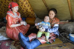 Russian Arctic Aboriginal Women German women with children in the apartment house - the plague! Royalty Free Stock Photo