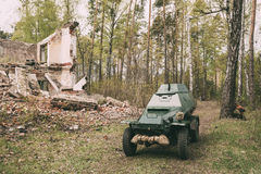 Russian Armoured Soviet Scout Car BA-64 Of World War II In Sprin. Russian Armoured Soviet Scout Car BA-64 Of World War II Near Ruined Building In Spring Forest Stock Photos