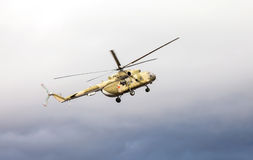 Russian army Mi-8 helicopter in action against cloudy sky Royalty Free Stock Image