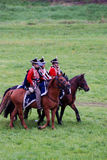 Russian army soldeirs -  reenactors ride horses at Borodino Royalty Free Stock Photo
