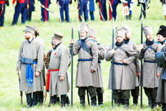 Russian army soldiers-reenactors stand in a group. Royalty Free Stock Photography
