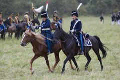 Russian army soldiers ride horses at Borodino battle historical reenactment in Russia. BORODINO, MOSCOW REGION - SEPTEMBER 03, 2017: Borodino battle historical Royalty Free Stock Images