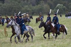 Russian army soldiers ride horses at Borodino battle historical reenactment in Russia. BORODINO, MOSCOW REGION - SEPTEMBER 03, 2017: Borodino battle historical Stock Images