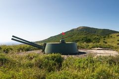 Russian artillery battery turret gun, Cannon on the Hill. Russia, Primorskiy Region, historical monument on Gamov peninsula. Russian artillery battery turret stock images