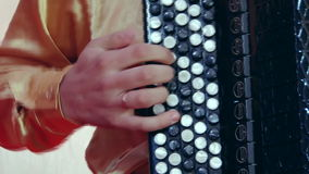 Russian artist playing accordion, close up. stock footage