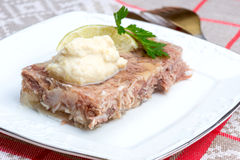 Russian aspic - kholodets with chopped horseradish (chren) Stock Photography