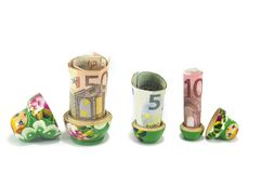 Russian babushka  dolls with euro bills isolated Stock Images