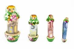 Russian babushka  dolls with euro bills isolated Stock Photos