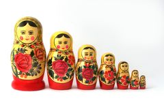 Russian Babushka Nesting Dolls. Babushka dolls in a row, isolated on white royalty free stock photography