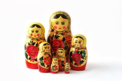 Russian Babushka Nesting Dolls. Babushka dolls in group, isolated on white stock image