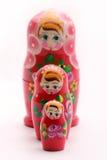 Russian Babushka Nesting Dolls. Image of babushka dolls in a row, isolated on white stock photos