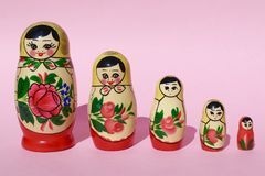 Russian Babushka Nesting Dolls on Pink Background. Group of Five royalty free stock images