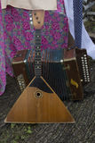 Russian balalaika and accordion. From Russia with love. Russian folk instruments. Welcome to Russia. A summer festival Royalty Free Stock Images
