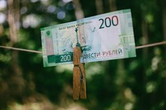 Russian Banknote Two hundred rubles hanging on the clothespin royalty free stock photography