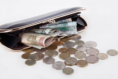 Russian banknotes and coins in the black purse on white backgrou Royalty Free Stock Photo