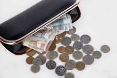 Russian banknotes and coins in the purse Stock Photo