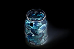 Russian banknotes--Five Thousand Ruble Notes in a glass jar (in UV light protection ).  Stock Images