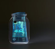 Russian banknotes--Five Thousand Ruble Notes in a glass jar (in UV light protection ).  Royalty Free Stock Image