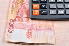 Russian banknotes five thousand rubles and the calculator are on Royalty Free Stock Images