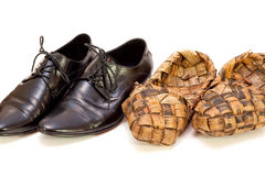 Russian bast shoes and man's shoes Stock Images